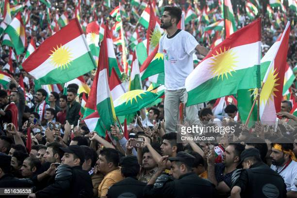 Kurdish people show their support for the upcoming referendum for independence of Kurdistan at a massive rally held at the Erbil Stadium on September...