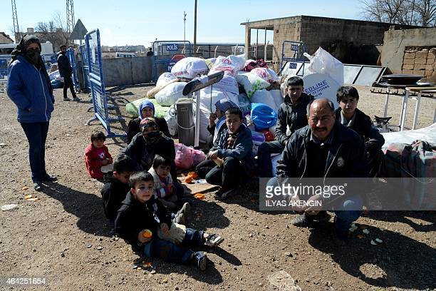 Kurdish people wait at the Mursitpinar border crossing to return to the Syrian city of Kobane also known as Ain alArab at Sanliurfa on February 23...