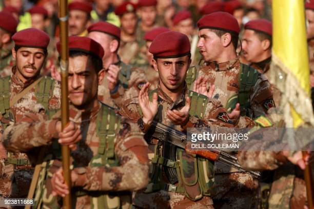 Kurdish People's Protection Units military police members demonstrate with their flags in the Kurdish town of AlMuabbadah in the northeastern part of...