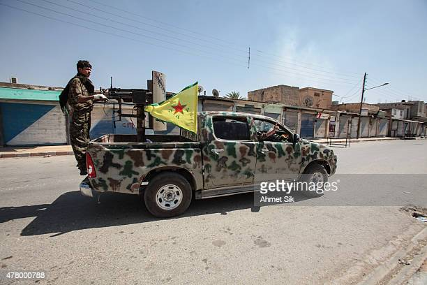 Kurdish People's Protection Units or YPG fighters control downtown of Tal Abyad Syria June 19 2015 Kurdish fighters with the YPG took full control of...