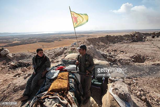 A Kurdish People's Protection Units or YPG fighters controls a check point in the outskirts of the destroyed Syrian town of Kobane also known as Ain...