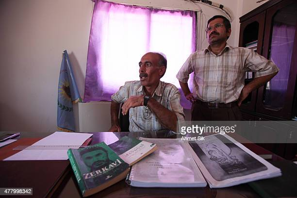 Kurdish People's Protection Units or YPG officers shows the documents and a book of Abu Musab alZarqawi leader of alQaeda of the fleeing Islamic...
