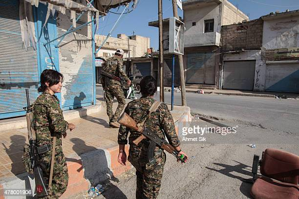 Kurdish People's Protection Units or YPG woman fighters controls a road in Tal Abyad Syria June 19 2015 Kurdish fighters with the YPG took full...