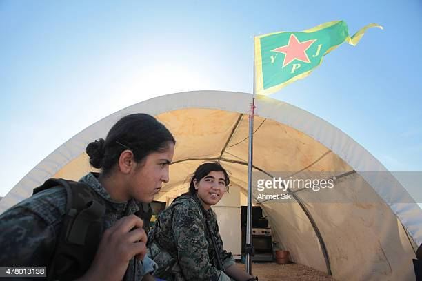 A Kurdish People's Protection Units or YPG women fighters rests a base camp at the outskirts of the destroyed Syrian town of Kobane also known as Ain...