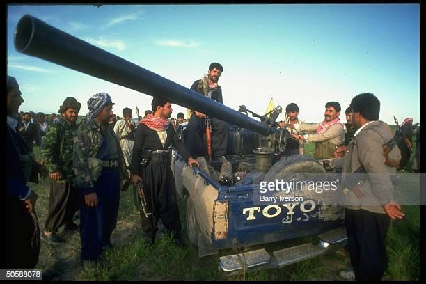 Kurdish pesh merga w Toyota truckmounted antiaircraft gun preparing for battle w forces of Saddam Hussein in postgulf war uprising