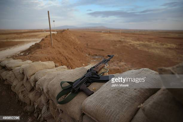 Kurdish Peshmerga assault rifle sits atop a sandbagged position along on the frontline with ISIS November 5, 2015 near Telskuf in northern Iraq. All...