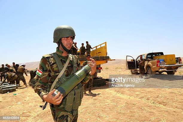 Kurdish peshmerga fighter holds a missile during the clashes with the army groups led by Islamic State of Iraq and the Levant in Mosul Iraq on 8...