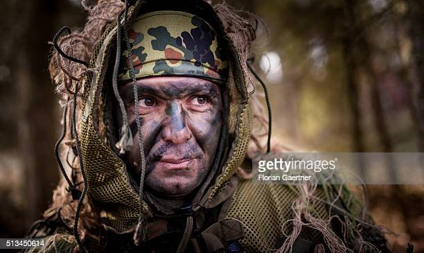 Kurdish peshmerga fighter looks during a Bundeswehr training session on March 1 2016 in Munster Germany The Bundeswehr is supporting Kurdish...
