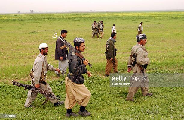 Kurdish Peshmerga fighters and US Special Forces advance April 6 2003 in Abushita northern Iraq Special forces who have been in the north in small...