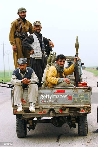 Kurdish Peshmerga fighters and U.S. Special Forces advance toward the road between Kirkuk and Mosul April 6, 2003 in Abushita, northern Iraq. Special...
