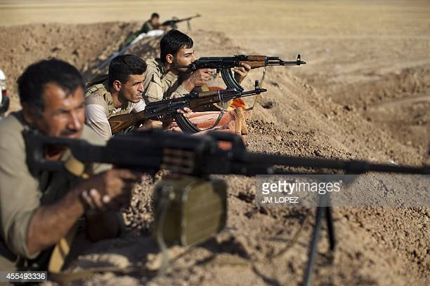 Kurdish Peshmerga fighters hold a position on the front line in the Gwer district 40 kilometres south of Arbil the capital of the Kurdish autonomous...
