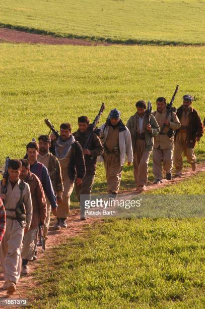 Kurdish Peshmerga fighters near the frontline near Pir Daud, wait for an imminent attack by the Iraqi army March 21, 2003 in Erbil, northern Iraq.