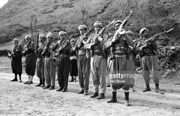 Kurdish Peshmerga fighters parade with Kalashnikov AK-47 assault rifles at a hidden military camp in the Zagros Mountains of northern Iraq, 10th May...