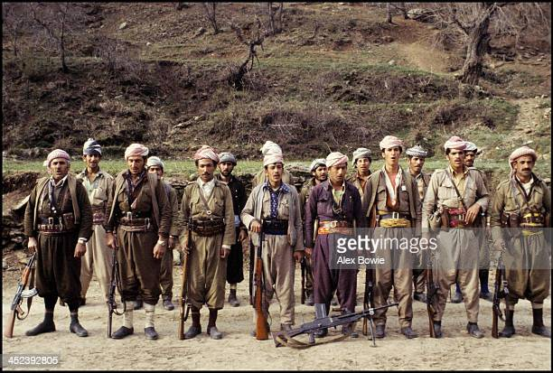 Kurdish Peshmerga fighters sing a patriotic song while on parade in a hidden military camp in the Zagros Mountains of northern Iraq, 10th May 1979.