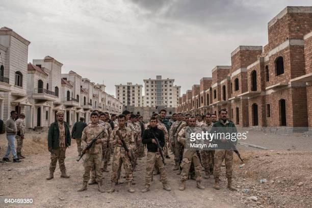 Kurdish Peshmerga fighters train in urban guerilla warfare on the outskirts of the city of Erbil in the Kurdistan Region of Iraq on November 17 2016...