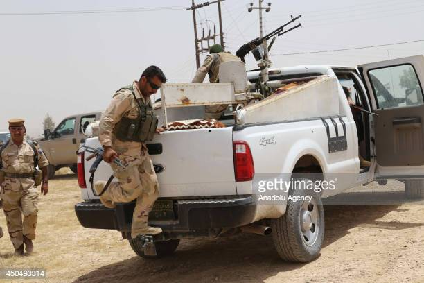 Kurdish Peshmerga forces and Iraqi special forces deploy their troops and armoured vehicles outside of the oil-rich city of Kirkuk, Iraq on June 12,...