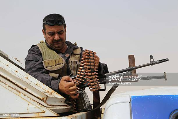 Kurdish Peshmerga forces and Iraqi special forces deploy their troops outside of the oil-rich city of Kirkuk, Iraq on June 12, 2014. The hardline...