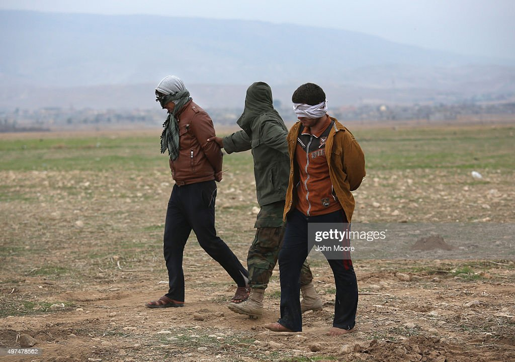 Kurdish Peshmerga forces detain suspected members of ISIL, or Daesh in Arabic, who mixed with a group of villagers fleeing the frontline to a Kurdish-controled area on November 16, 2015 to Sinjar, Iraq. Peshmerga forces carefully screened the displaced Iraqis as they arrived, fearing enemy infiltrators and suicide bombers. Kurdish forces, with the aid of massive U.S.-led coalition airstrikes, liberated Sinjar from ISIL extremists, known in Arabic as Daesh, moving the frontline south. About a thousand villagers in Ghabosyeh fled north to Kurdish held territory, to take refuge camps or onward as refugees to Turkey or Europe.