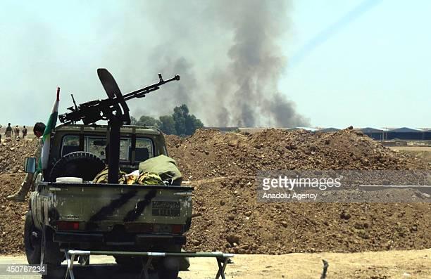 Kurdish Peshmerga forces fighting militants from Islamic State of Iraq and the Levant in the mid west Iraqi town of Tuzhurmatu in Kirkuk Iraq on June...