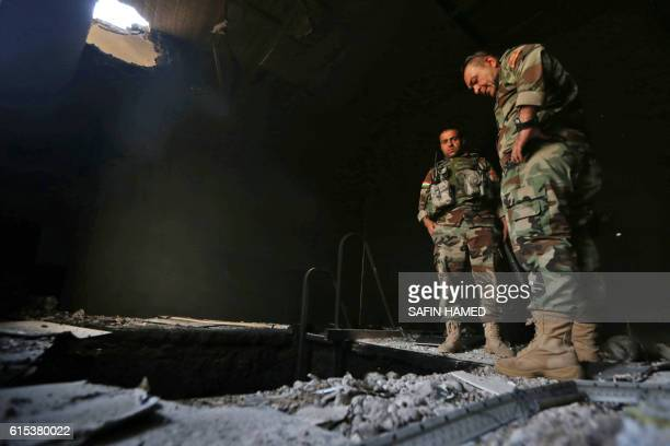 Kurdish Peshmerga forces inspect a tunnel on October 18 2016 inside a building in the Shaqouli village about 35 kms east of Mosul after they've...