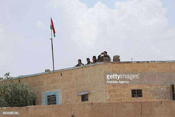 Kurdish Peshmerga forces seize the control of Mosul's district Rabia where Iraqi army forces and Islamic State of Iraq and the Levant had clashes and...