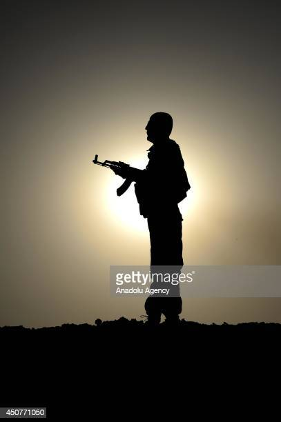 Kurdish Peshmerga forces stand guard in the oil-rich city of Kirkuk against Islamic State of Iraq and the Levant on June 17, 2014. Kurdish Peshmerga...