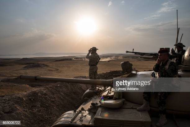 Kurdish Peshmerga forces stand in overwatch positions near the Mosul Dam in Northern Iraq August 18 2014 Iraqi officials said on Monday that Kurdish...