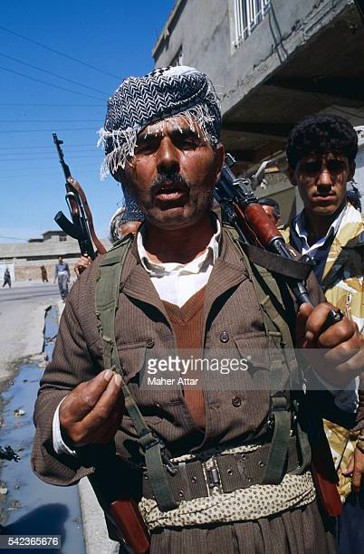 A Kurdish Peshmerga guerrilla celebrates a victory against the forces of Saddam Hussein in the northern Iraqi city of Irbil | Location Irbil Iraq