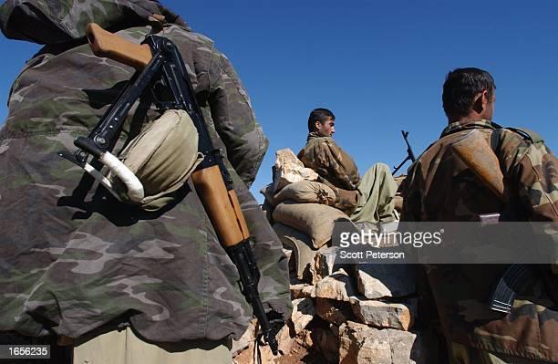 Kurdish peshmerga guerrillas man the front line against an Al Qaedabacked Kurdish Islamist group called Ansar alIslam which is holed up on a short...