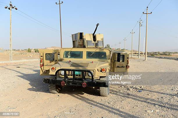 Kurdish peshmerga patrol of a bridge leading from Guver village to Mosul destroyed by army groups led by Islamic State formerly known as ISIL on...