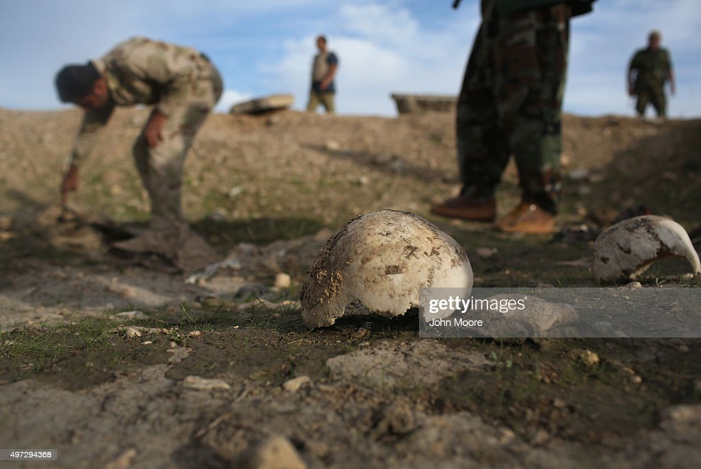 Kurdish Peshmerga show what they say is a mass grave of more than 50 Yazidis killed by ISIL on November 15, 2015 in Sinjar, Iraq. Kurdish forces, with the aid of massive U.S.-led coalition airstrikes, liberated Sinjar from ISIL extremists, known in Arabic as Daesh, in recent days. Local Yazidi fighters who fought with Kurdish forces have been taking any salvagable items out of the rubble, the town being uninhabitable and perilously close to the frontline.