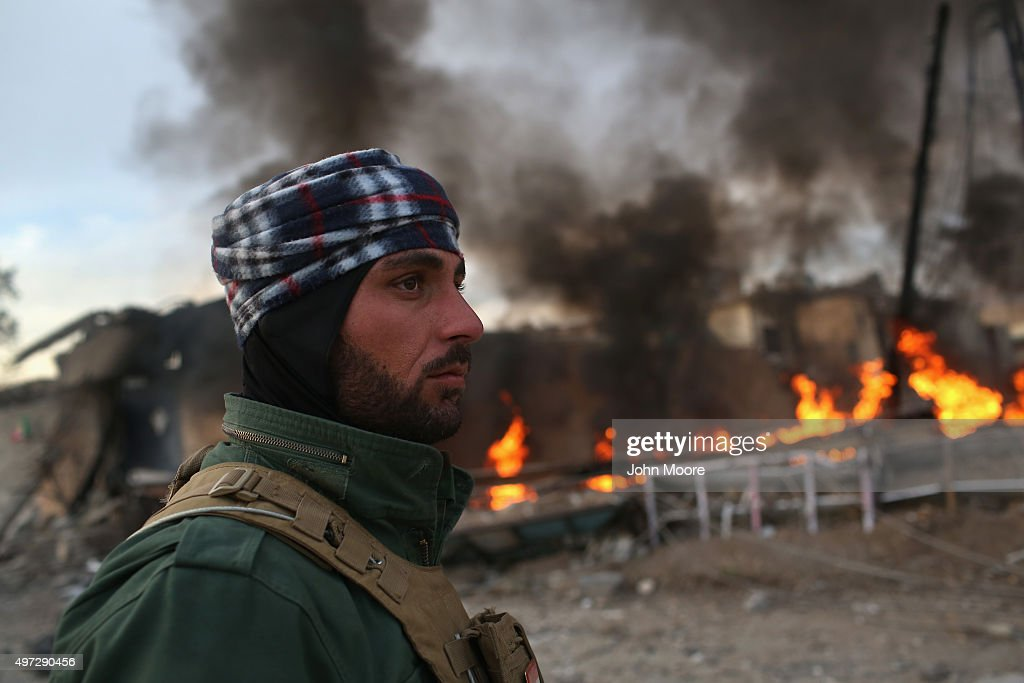 A Kurdish Peshmerga soldier passes by tires set afire days before by ISIL extremists to hinder airstrikes on November 15, 2015 in Sinjar, Iraq. Kurdish forces, with the aid of months of U.S.-led coalition airstrikes, liberated the town from ISIL extremists, known in Arabic as Daesh, in recent days. Although many minority Yazidis celebrated the victory, their home city of Sinjar lay in complete ruins. Local Yazidi fighters who fought with Kurdish forces and some former residents have been taking any salvagable items out of the rubble, the town being uninhabitable and perilously close to the frontline.
