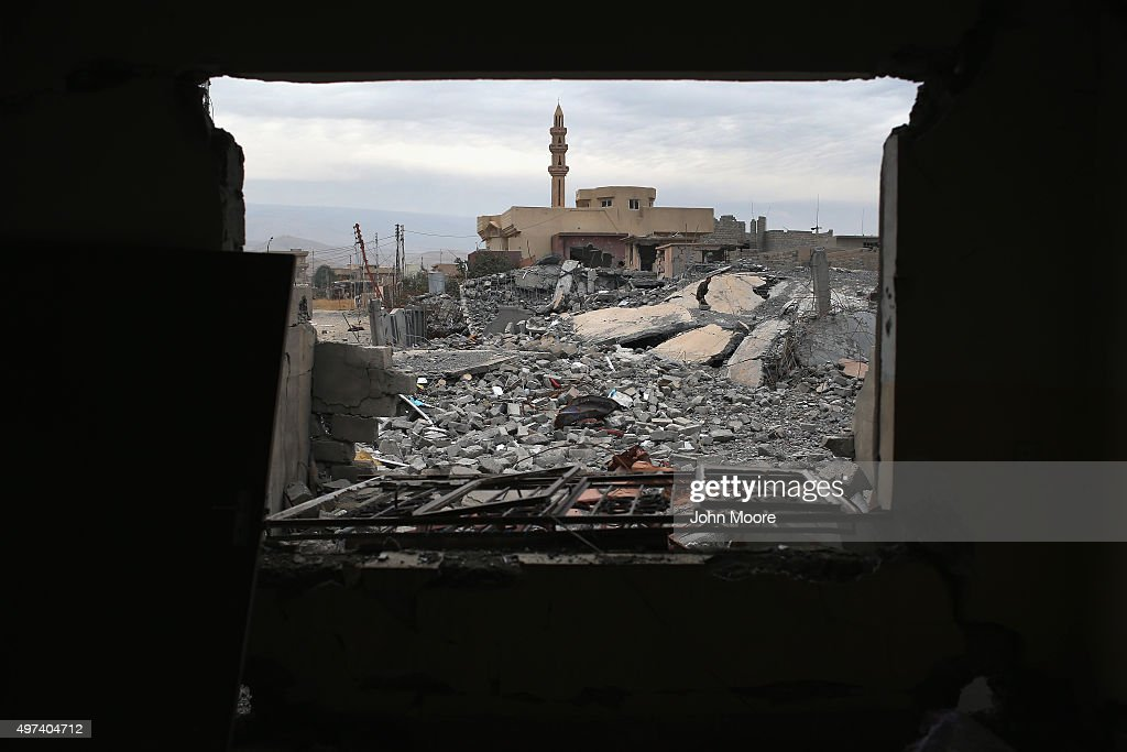 A Kurdish Peshmerga soldier searches for weapons in the rubble of an airstrike near a mosque on November 16, 2015 in Sinjar, Iraq. Kurdish forces, with the aid of months of U.S.-led coalition airstrikes, liberated the town from ISIL extremists, known in Arabic as Daesh, in recent days. Although the battle was deemed a major victory, much of the city lay in complete ruins.