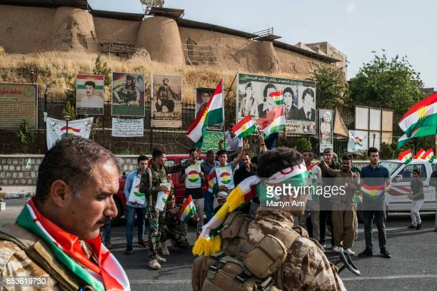SEPTEMBER 25 Kurdish Peshmerga soldiers provide security as Kurds gather to vote in a referendum for independence from Iraq and the establishment of...