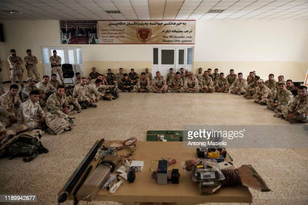 Kurdish peshmerga soldiers take part in a training military session conducted by Italian army, on August 22 in Bnaslawa Military Base in Erbil,...