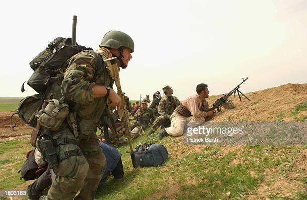 Kurdish Peshmergas and US Special forces are advancing into the outskirts of Baghdad April 3 2003 in Kalak Iraq Special forces infiltrated Iraqi...