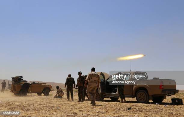 Kurdish peshmergas fight against Islamic State of Iraq and the Levant in Mosul, Iraq on 8 August, 2014.