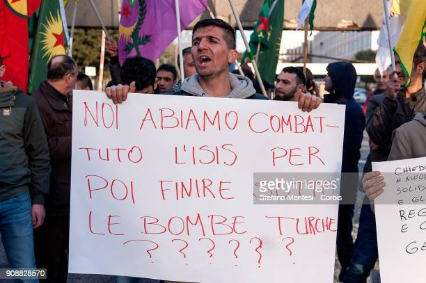 Kurdish protester holds a sign saying 'Have we fought ISIL to end up under Turkish bombs' during a Kurdish community protest near the Russian Embassy...