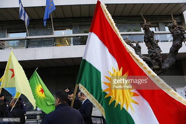Kurdish protester holds the Flag of Kurdistan outside the EU offices in Athens Kurdish people in Athens marched to the EU offices in Athens...