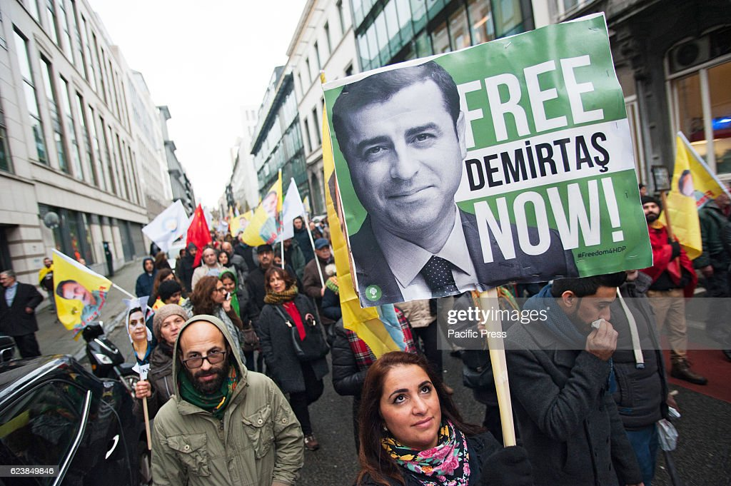 A Kurdish protester holds up a banner for Demirtas at a... : News Photo