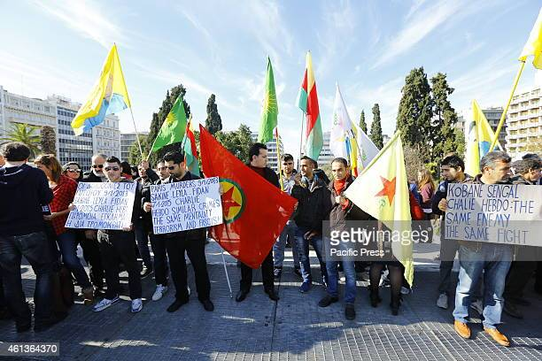 SQUARE ATHENS ATTICA GREECE Kurdish protesters have joined the 'Je suis Charlie' vigil carrying Kurdish and PKK flags A second vigil by Greeks and...