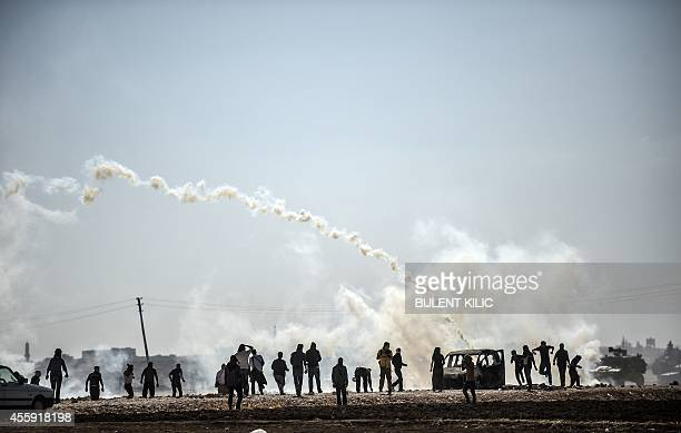 Kurdish protestors clash with Turkish soldiers near the Syrian border after Turkish authorities temporarily closed the border, blocking young Syrian...