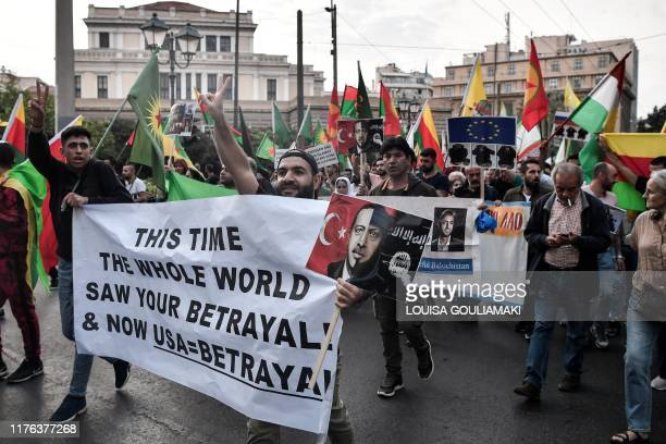 Kurdish protestors hold a banner as they walk towards the US embassy in Athens during a demonstration march on October 17 2019 to protest against...