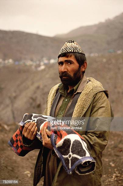 A Kurdish refugee father buries his child at a camp in the mountains near Isikveren in southeastern Turkey April 1991 The camp straddles the...