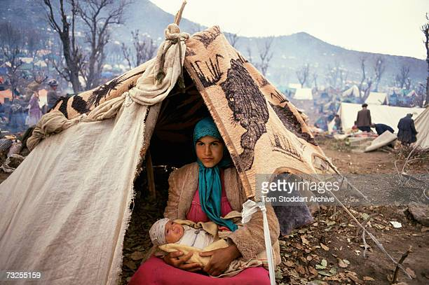 A Kurdish refugee mother and her baby at a camp in the mountains near Isikveren in southeastern Turkey April 1991 The camp straddles the TurkishIraqi...