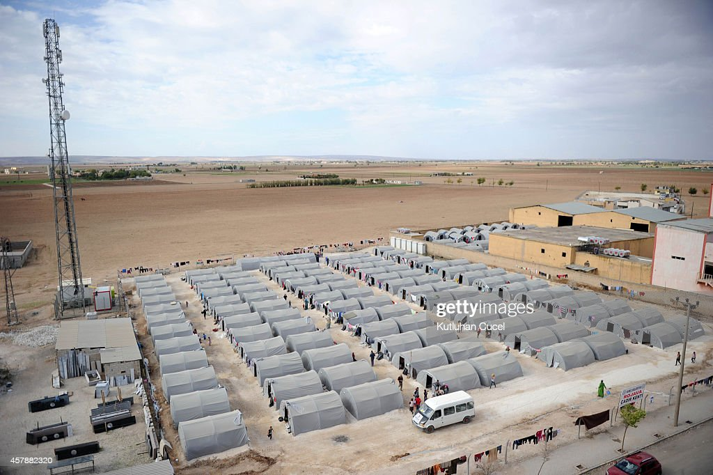 Kurdish refugees live in tents in a refugee camp on October 26, 2014 in the southeastern town of Suruc, Turkey.The Syrian town of Kobani has yet again seen fierce fighting between Islamic State and Syrian Kurdish forces. Since mid-September, more than 200,000 people from Kobani have fled into Turkey.