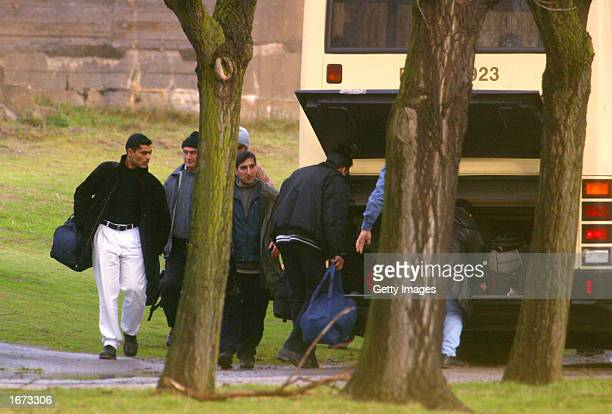 Kurdish refugees part of 41 on their way to be legally relocated to England from the Sangatte refugee camp pack up a bus December 5 2002 in Calais...