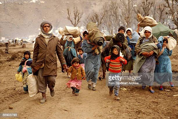 Kurdish refugees photographed at a camp in the mountains near Isikveren Turkey The camp straddled the TurkishIraq border and was a refuge for...