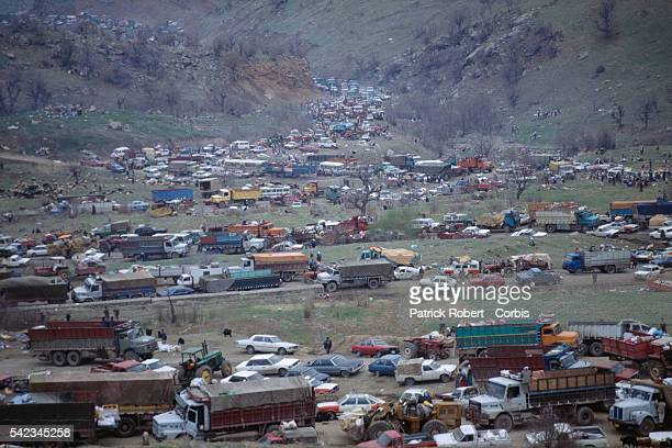 Kurdish refugees reach the northern Iraq mountains which will lead them to Turkey Because of the lack of gas few vehicles were able to go up the slope