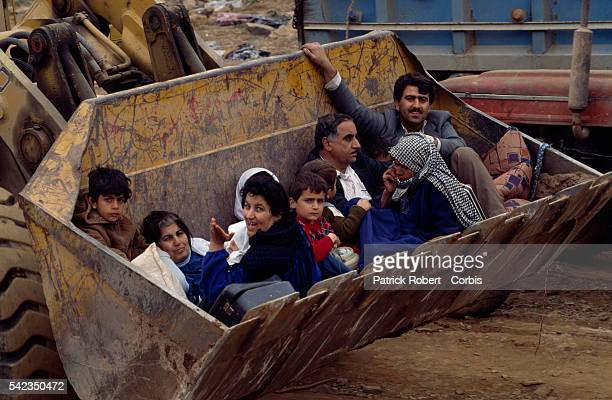 Kurdish refugees reach the northern Iraqi mountains that will lead them to Turkey Because of the lack of gas few vehicles were able to go up the...